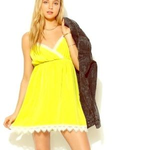 Chartreuse lace detailed slip dress.